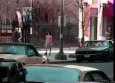 Walking down street topless