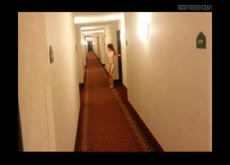 woman caught naked in hallway