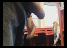 Blonde teen girl taking a good look in the library