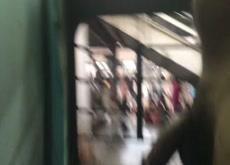Indian flashing from running train