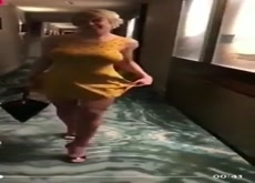 Stacked Blonde Flashing in Hotel Hallway