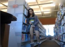 Webcam Girl Plays with Dildo in Public Library